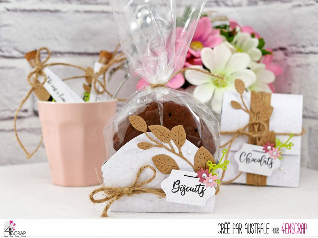 Boite pour petits biscuits en papier rose, feuillages en kraft, vert et quelques fleurettes roses.