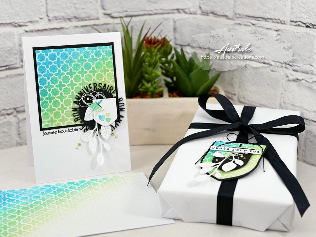 Ensemble composé d'une carte, d'une étiquette et d'une enveloppe avec fond distress et pochoir dans un combo de bleu, vert, jaune et noir.