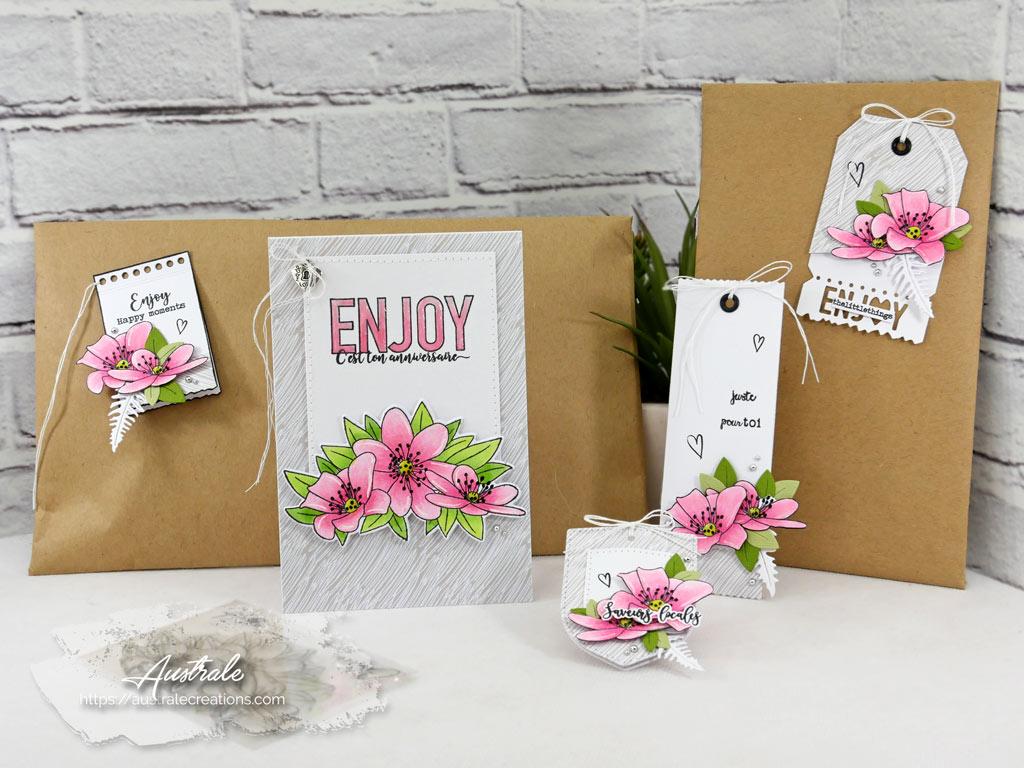 Ensemble scrap composé d'une carte et d'étiquettes cadeaux pour anniversaire avec anémones sur fond blanc et gris.