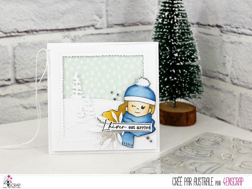 Carte d'hiver avec un cadre sur mise en scène de collines et sapins enneigés et une adorable scrapgirl emmitouflée dans son écharpe et son bonnet.