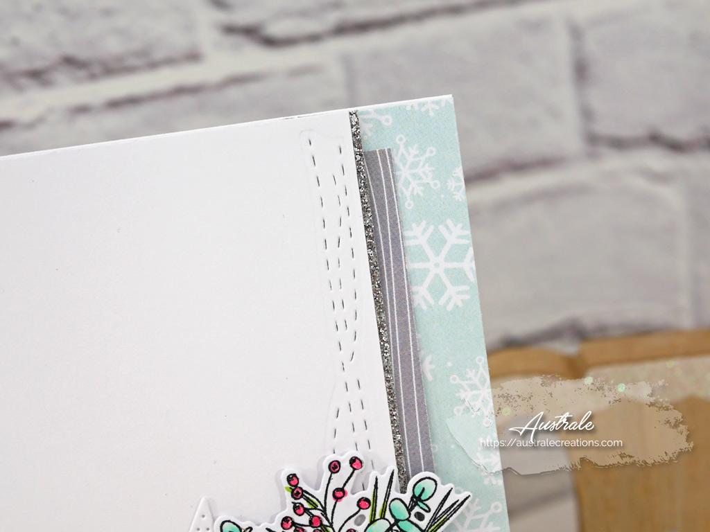 Carte de voeux en gris et menthe avec étoile, raquette de ski, feuillages et quelques perles argentées.