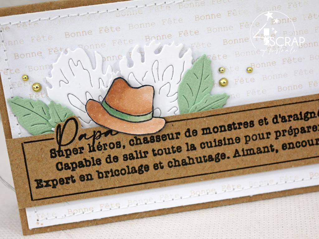 Carte pour la fête des pères avec la définition du papa super héros, chapeau et feuillages.