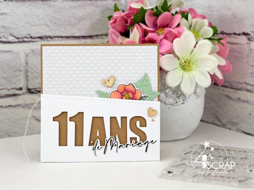 Carte pour anniversaire de mariage dans un combo en rose, vert, kraft, magnolias, transparences, feuillages et petits coeurs en bois.