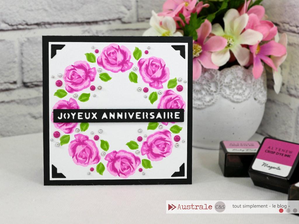 Carte d'anniversaire en noir, rose, vert, avec couronne de roses vintages d'Altenew en multi tamponnage, étiquette joyeux anniversaire et perles.