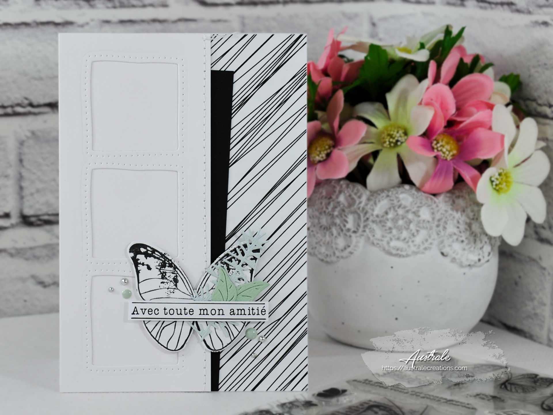 Création d'une carte d'amitié en noir et tons pastels avec feuillages et papillon.