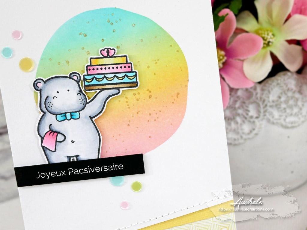 Carte d'anniversaire de pacs avec un hippopotame tenant un gateau.