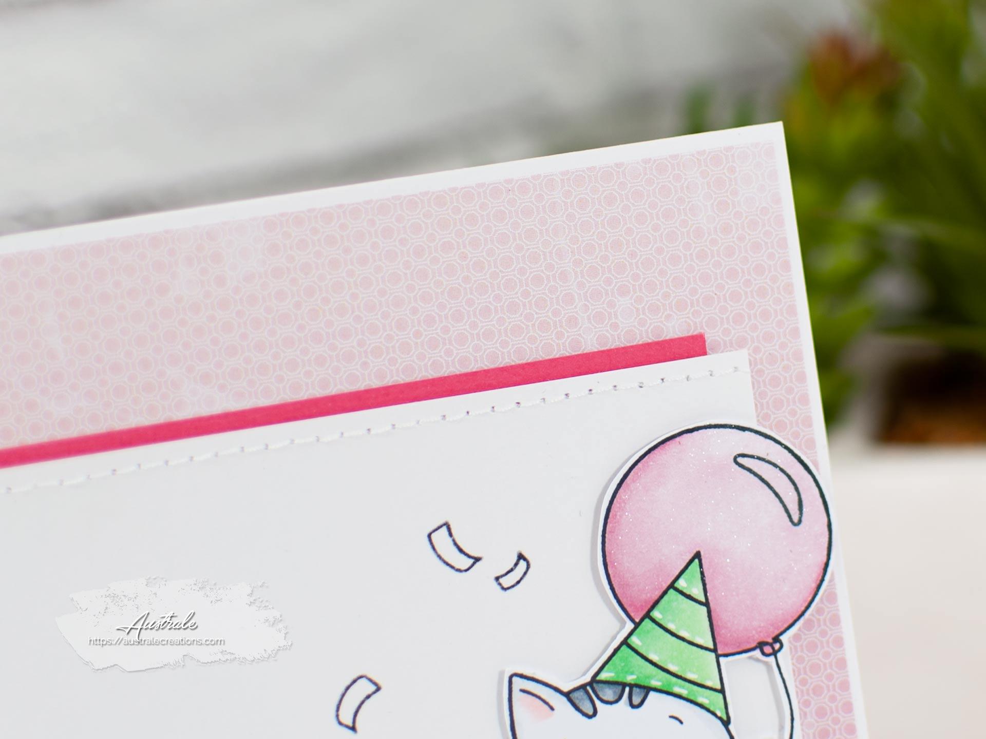 Création d'une carte d'anniversaire avec un adorable petit chat et son ballon sur fond rose.