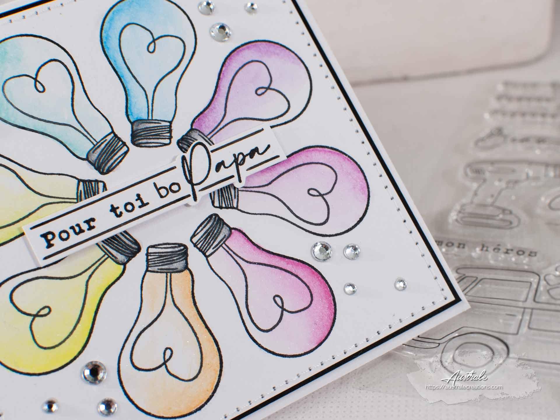 """Création d""""une carte pour la fête des pères avec couronner d'ampoules aux couleurs de l'arc en ciel."""