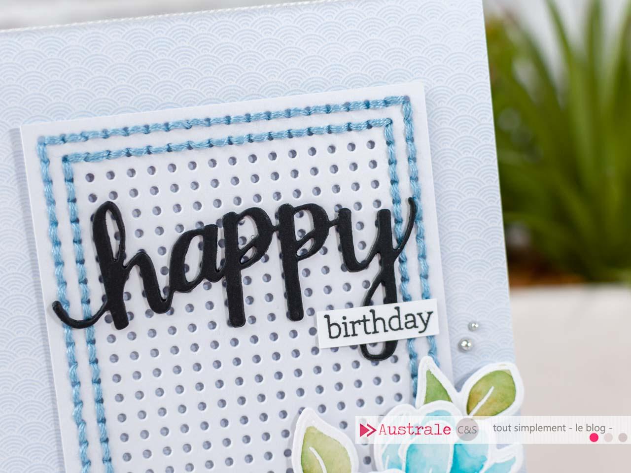 Création d'une carte d'anniversaire avec cadre brodé à la main et fleurs embossées et mises en couleurs à l'aquarelle.